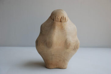 Amazing wood carved sculptures that look like people and objects are trapped inside by Tung Ming-Chin