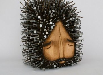 Stunningly figurative wood sculptures pierced with hundreds of nails by Jaime Molina
