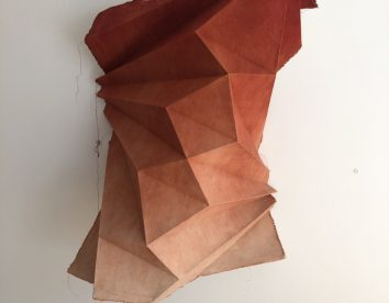 Naturally dyed cotton fabrics shaped into abstract origami figures by Sipho Mabona