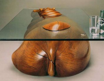 Stunning sculptural coffee tables of animals floating through the water cleverly designed by Derek Pearce