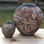 Wonderful ceramics with colorful multi-layered streaks carved onto their surfaces by Sean Forest Roberts